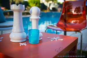 Classic Chess pieces and orange acrylic chairs along with custom 3D printed coasters